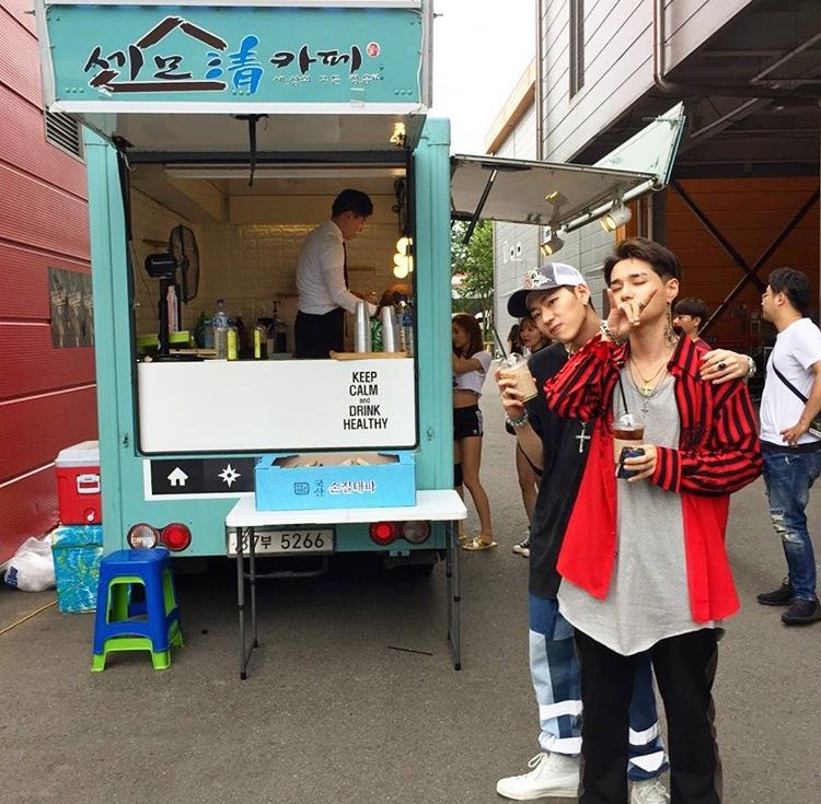 dean x zico in front of their food truck...
