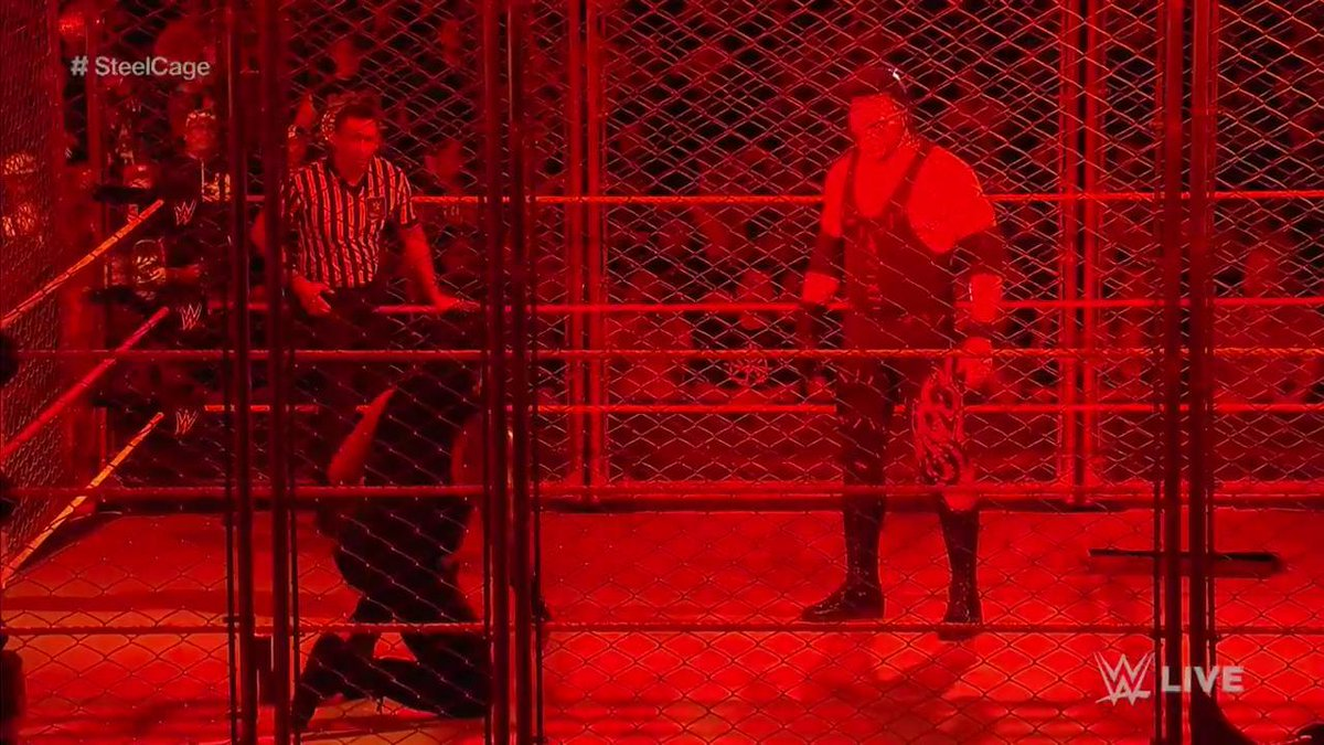 OH. MY. GOODNESS!  WHAT IS @KaneWWE DOING HERE?! #RAW #SteelCage https...