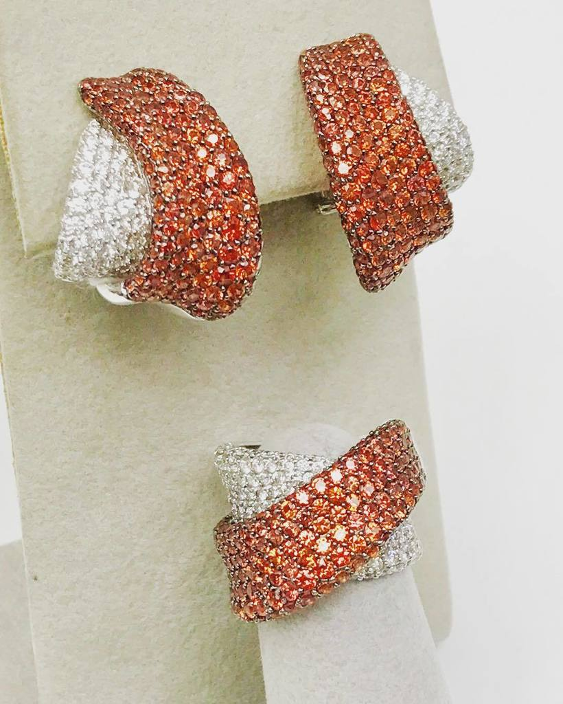 Jimmy Quiroga (R) Designs Orange Sapphire and Diamond Cross-over Earrings and Ring. Just in time for Fall! #jim…  http:// ift.tt/2ghMvdK  &nbsp;  <br>http://pic.twitter.com/XKd1gyn6tg
