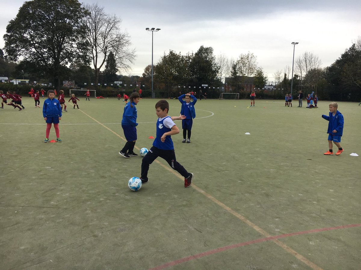 Football warm up underway for the Year 3/4 mixed tournament. @premierleague #youngstars