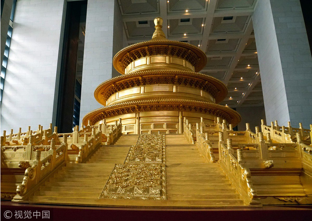 A 3.8M tall model of 'the Temple of Heaven' that is made of teak & covered in gold foil is on display at China National Museum in Beijing