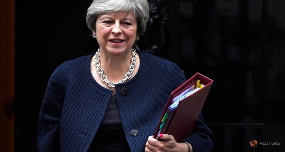 Trying to unblock Brexit impasse, May to...