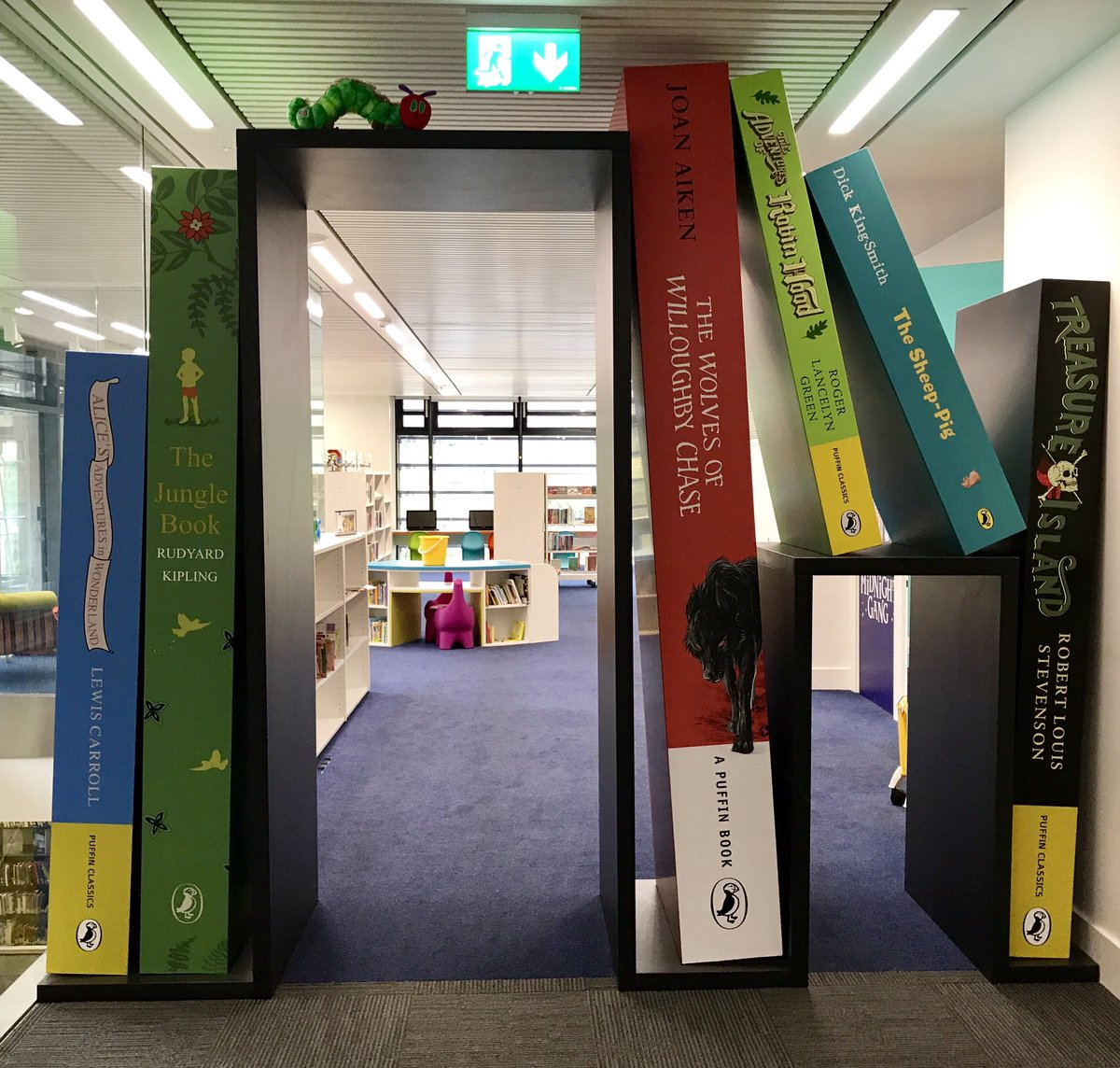 The fab walkway of giant books to the children&#39;s area of our new library #BookWorm @CMBClibraries @DickKingSmith<br>http://pic.twitter.com/uzS5gaq8Ko