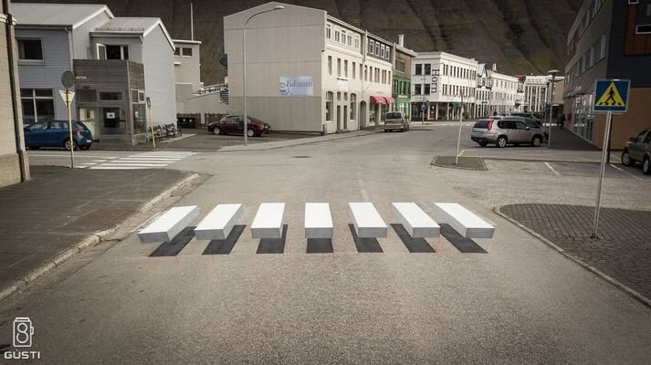 This optical illusion on a pedestrian crossing in Iceland to oblige cars to brake #fridayfeeling #travel #FacMan c @robertoglezcano<br>http://pic.twitter.com/Gapo3z9DIT