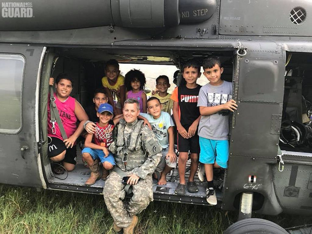 A @NationalGuardNY #pilot befriends local #kids while delivering aid supplies in #PuertoRico in response to #HurricaneMaria.<br>http://pic.twitter.com/Y5Yhz6OAM0