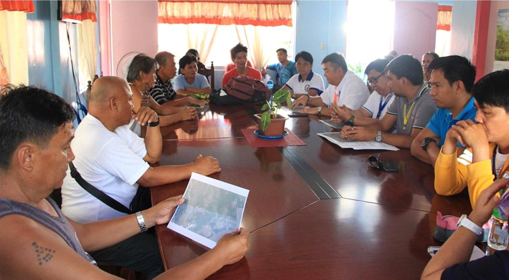 LOOK: DPWH officials and affected property owners met to discuss the road project in Brgy San Juan, Ormoc City. (DPWH Photo) | @MB_unite