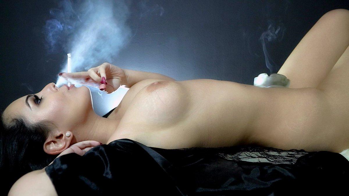 Beautiful sexy brunette girl with bright makeup red lips smoke stock photo