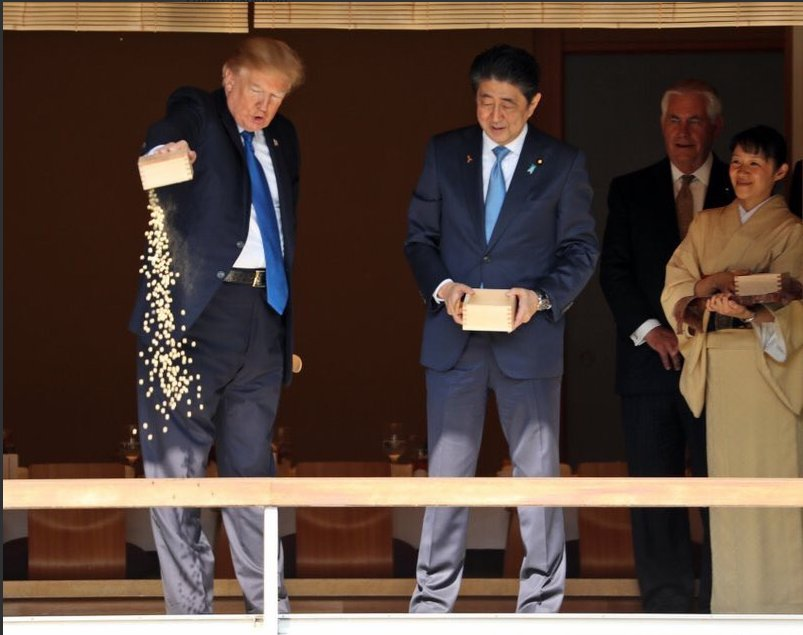This Photo Of Trump Dumping Carp Food In A Pond In Japan Has Become A Huge Meme