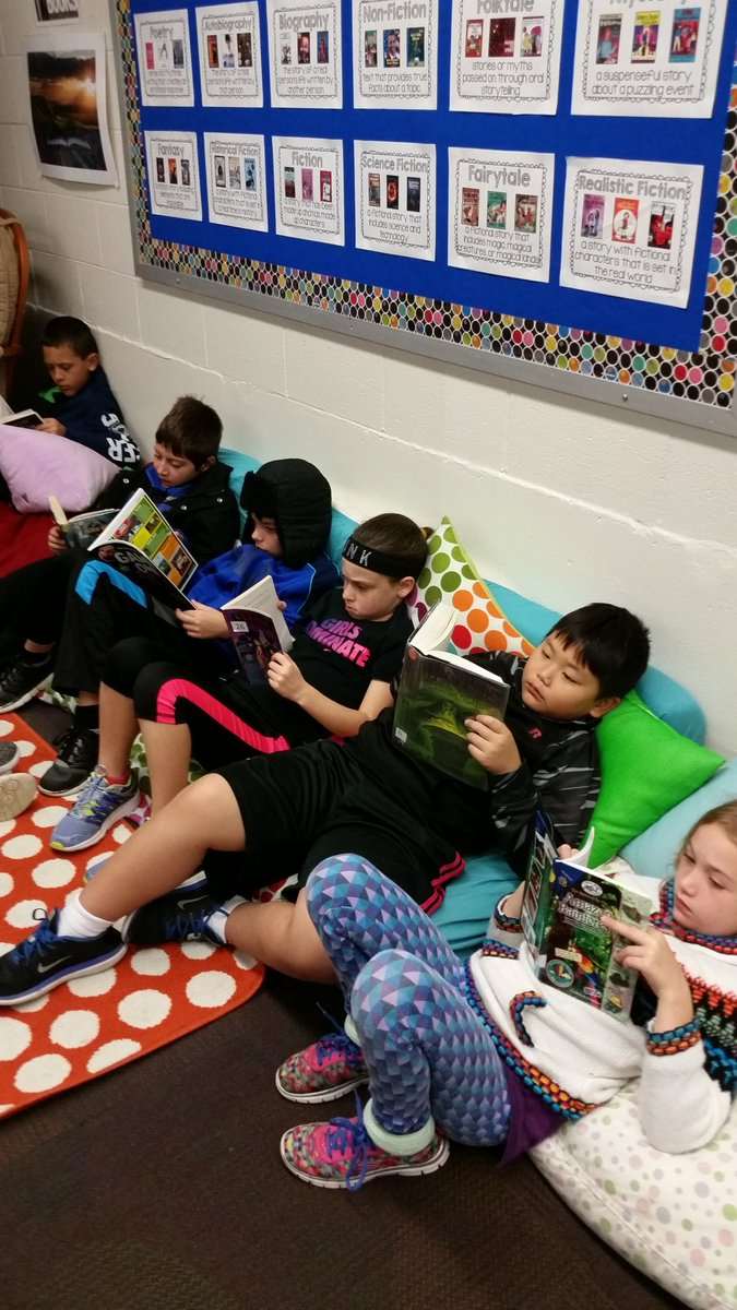 I love when kids are so engaged in reading that they don't even notice they are getting their picture taken!