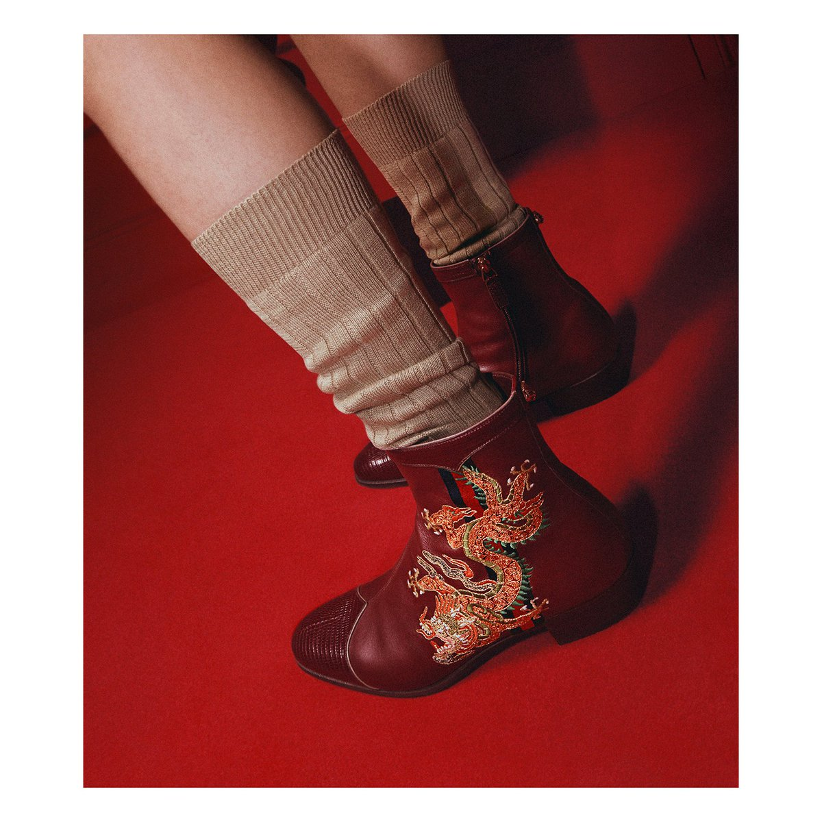b9c6c5763 Ankle boots from #GucciCruise18 leather featuring the Web stripe and an  embroidered dragon.