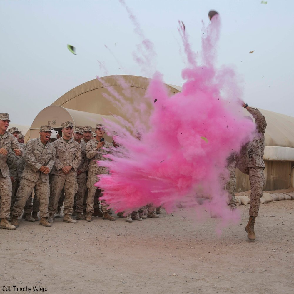 .@USMC Capt. Gregory Veteto punts a football sent by his wife revealing the gender of his baby during a weekly formation.