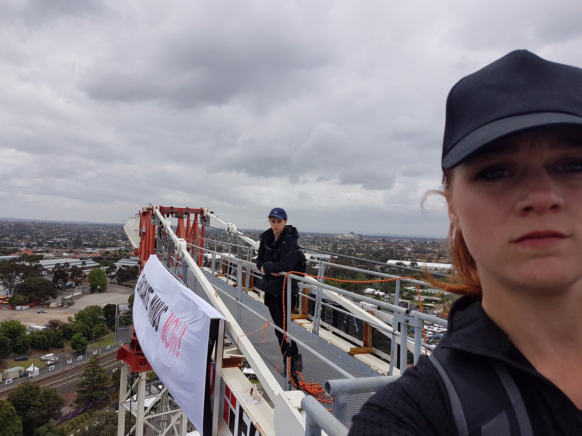 Go you good things! These two have scaled a crane at #melbournecup with a message for Turnbull #evacuatenow
