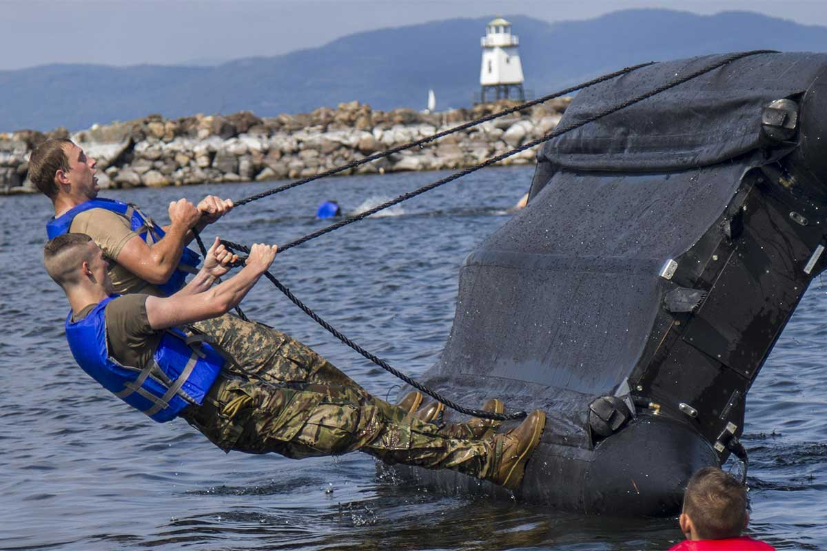 This isn't the water skiing we had in mind.   @USArmy @USNationalGuard #soldiers right a Zodiac boat during boat capsizing training in #Vermont. The training helps improve proficiency in water-based recon missions. <br>http://pic.twitter.com/ued5z2nMFs