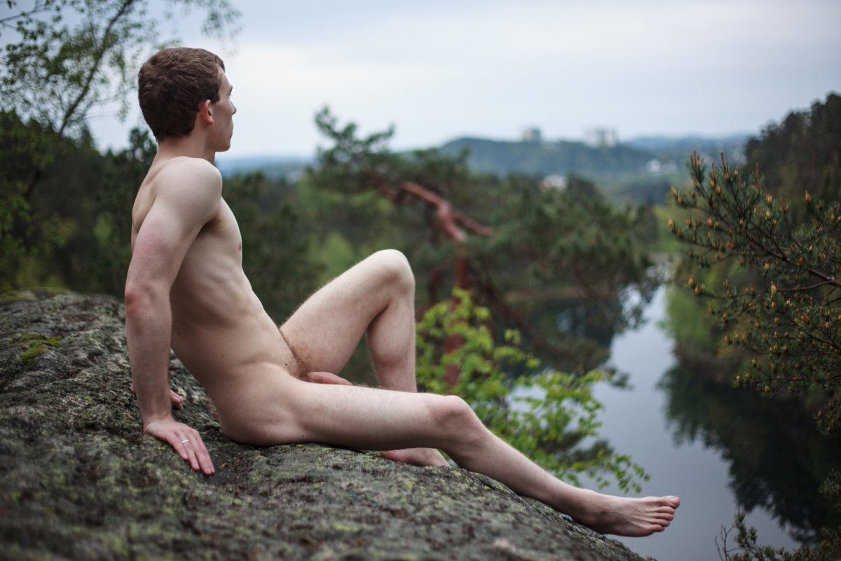 Young man relaxing on naked woman
