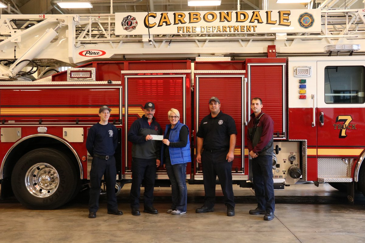 The Carbondale Fire Dept. presented @SIHealthcare with a $600 check this morning from its #breastcancer t-shirt sales. The funds will be used for SIH&#39;s Cancer Care Patient Support Fund. <br>http://pic.twitter.com/PDfR0JrIqx