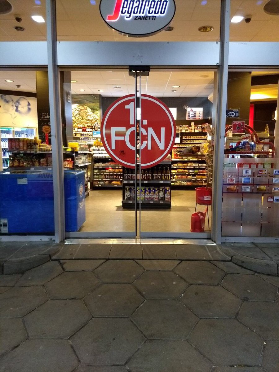 My good friend @AiTinpot is in Nürnberg where brilliantly even the petrol station doors are in #FCN club colours: <br>http://pic.twitter.com/9vGLklpset