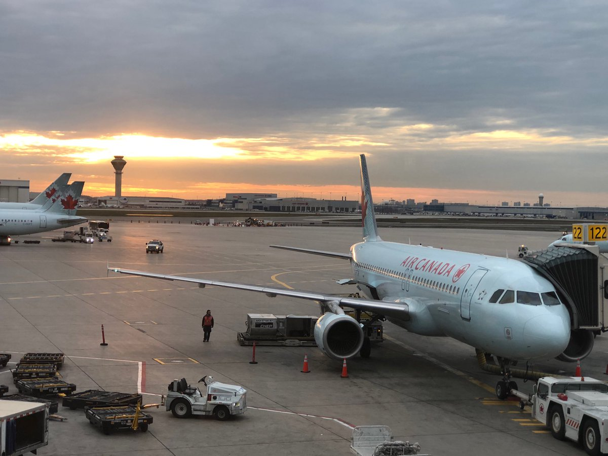 The sun is setting over Toronto. Slightly delayed take off for Halifax.