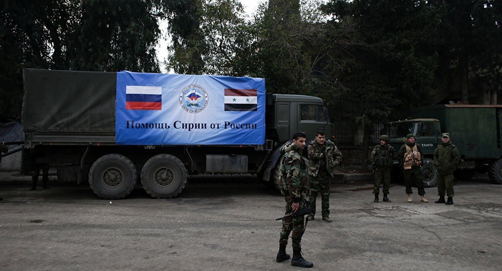 #Russia delivered #Humanitarian aid,Food baskets to 500 Families in Al-Shaqranieh in North #Daraa &amp; provided Medical assistance to the needy and Sick people,Representative of the #Russian coordination center,the #Russian support to #Syria and its people will continue. <br>http://pic.twitter.com/rWcBKU7VRy