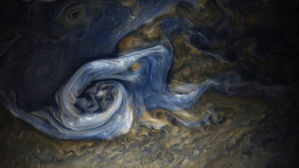 See that swirling cloud that looks like cream in coffee? It's actually a massive, raging storm in Jupiter's northern hemisphere, seen by @NASAJuno. Take a look: https://t.co/jH8hV4OESA
