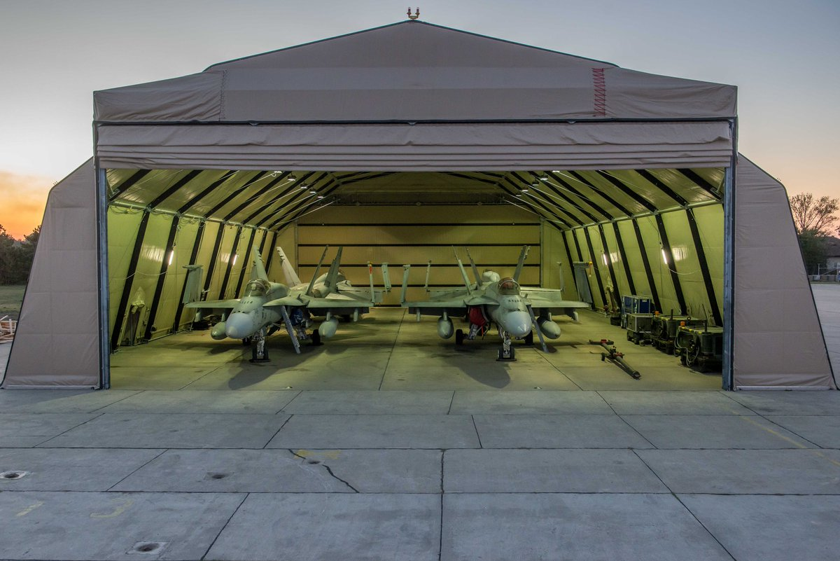 4 @RCAF_ARC CF-188 Hornets sit cozily in their newly constructed shelter in Romania.  These aircraft are supporting #NATO air policing as part of #OpREASSURANCE   #WeAreNATO #avgeek<br>http://pic.twitter.com/Xb5nLRGJVj