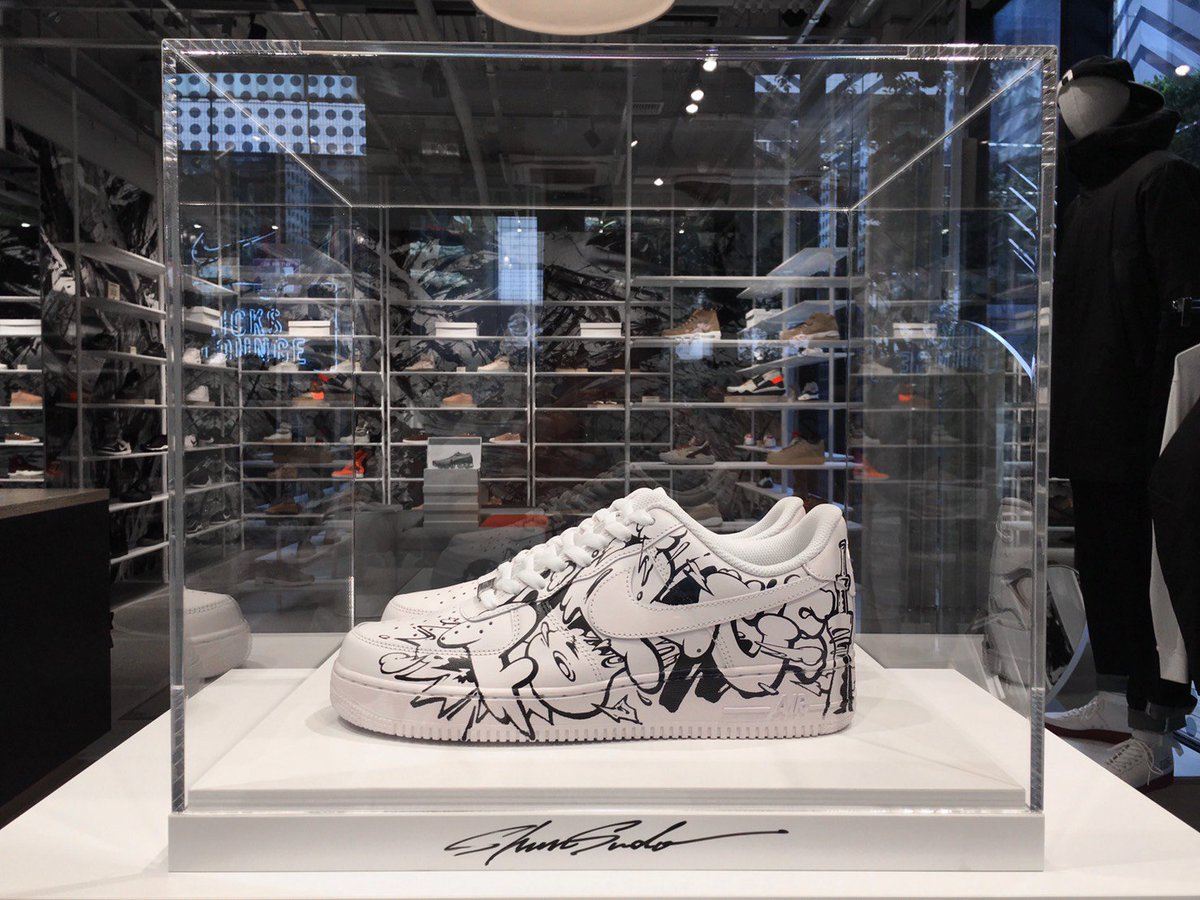 11bc4376e135 ... spain japanese artist shun sudo paints a pair of white nike air force 1  sneakers with