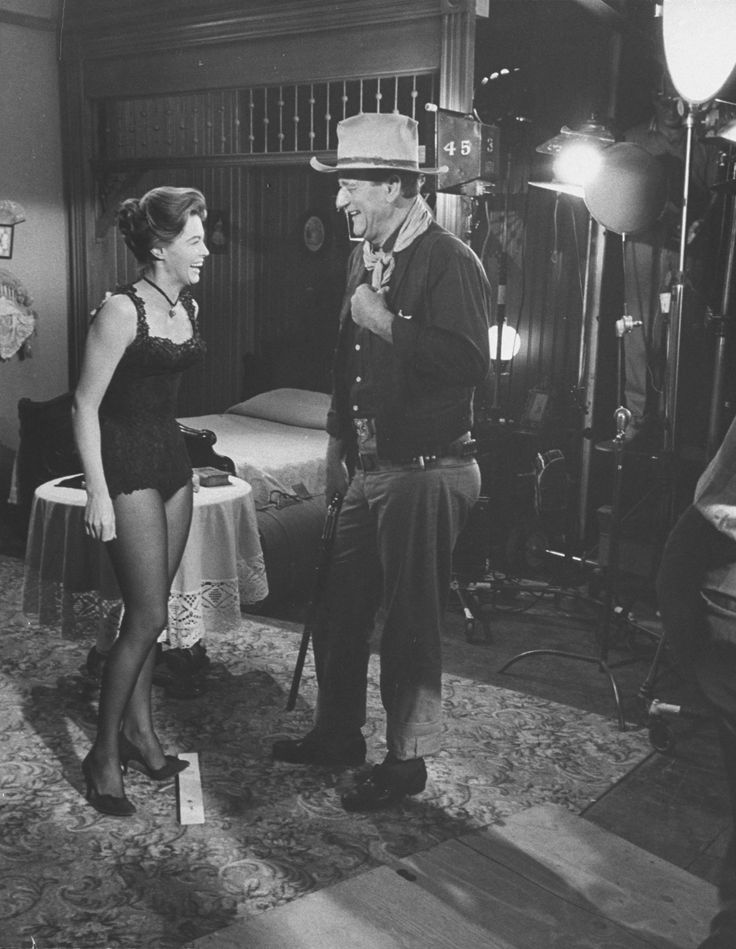 Angie Dickenson and John Wayne share a laugh between takes during the filming of Rio Bravo. #stgeorgeprod #JohnWayne <br>http://pic.twitter.com/ozsfaDBa5o