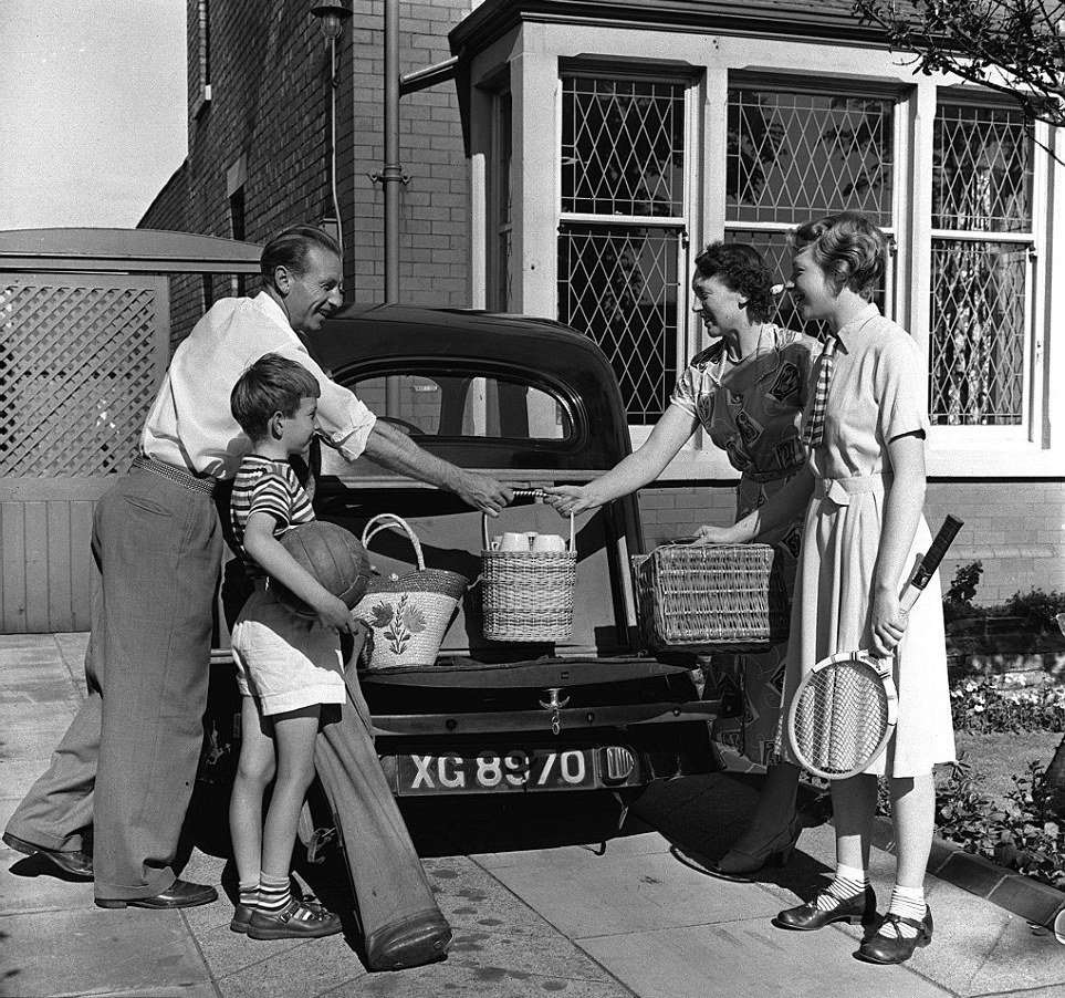 Sir Stanley Matthews and family loading up the car for a picnic 1954