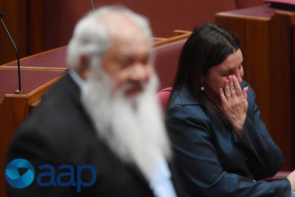 Senator Jacqui Lambie reacts as she list...