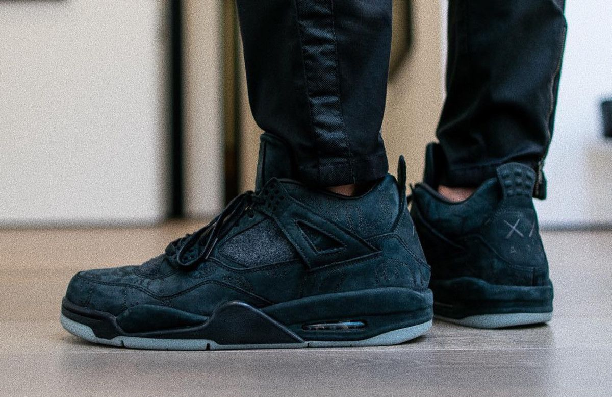 9d57866558bb77 the kaws x air jordan 4 black will launch on cyber monday
