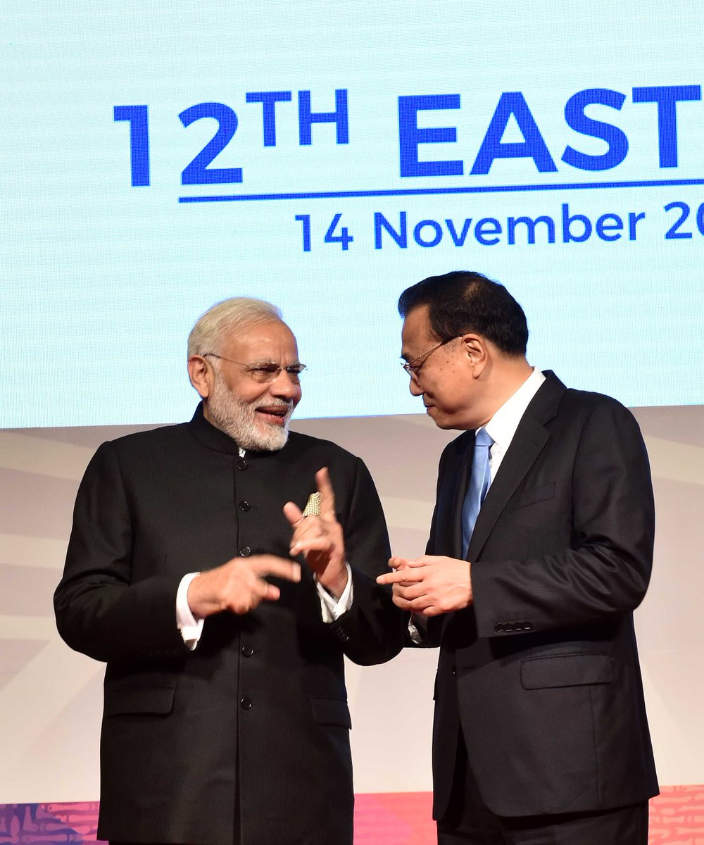 Prime Minister @narendramodi and Premier of China, Mr. Li Keqiang interact during the East Asia Summit. https://t.co/OvuE4rkcQ7