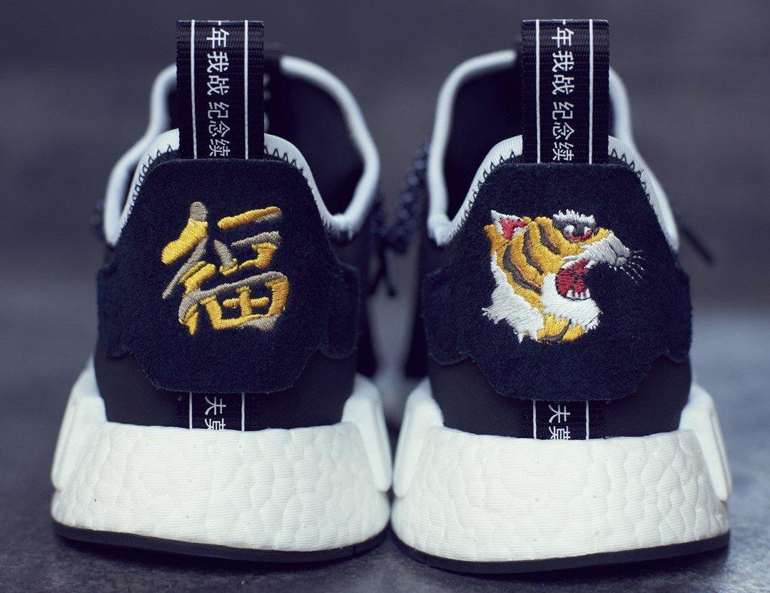 First Look: adidas NMD Human Race 'Tangerine' Sneakers Cartel