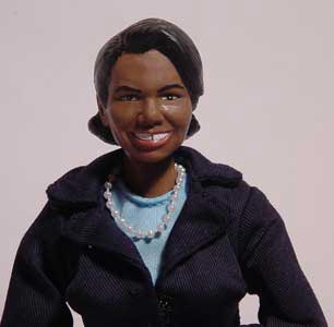Happy birthday Condi! that my Condoleezza Rice doll looks more like Mike Tyson in drag: