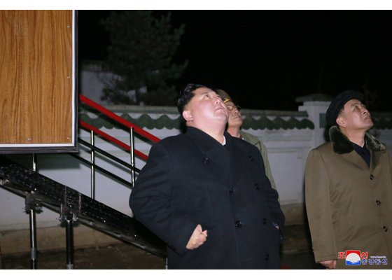 North Korea releases photos of leader Kim Jong Un watching long-range missile test
