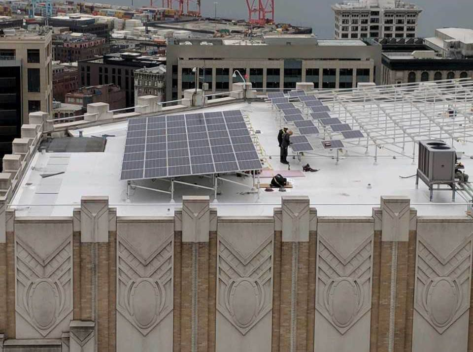 Solar panels being installed on the roof of Harborview Medical Center, Seattle, 2017.