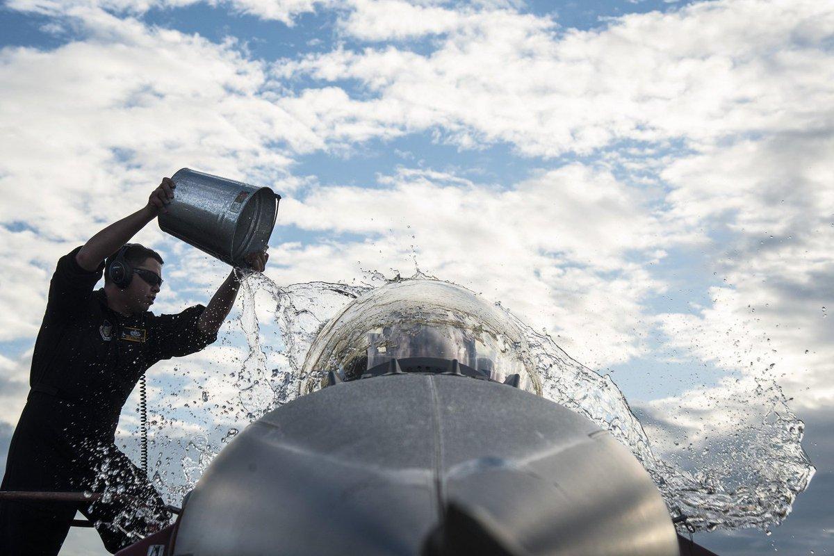 🎶Working at the … plane wash🎶  @usairforce #airman throws water on an F-16 Fighting Falcon at Nyutabaru Air Base, #Japan.