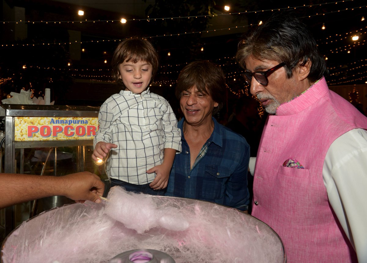 T 2716 - And as for this little bundle .. he wanted the fluffy 'buddhi ka baal' cone .. so we took him to the stall made one for him and the joy of getting it is just priceless .. Abram, jr Shahrukh .. delectable !!