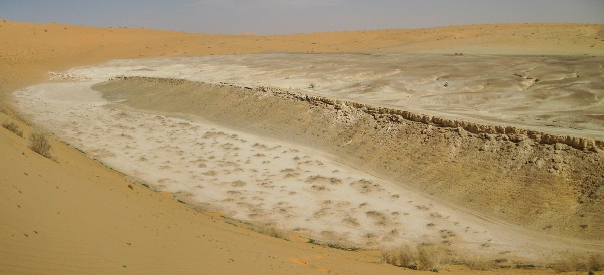 An ancient lake deposit hidden within the dunes of the western Nefud Desert, Saudi Arabia. I&#39;m studying deposits like these as part of my #PhD to better understand the nature and timing of wetter phases in the Nefud Desert, and how they could have supported human populations. <br>http://pic.twitter.com/17CG8kclAy