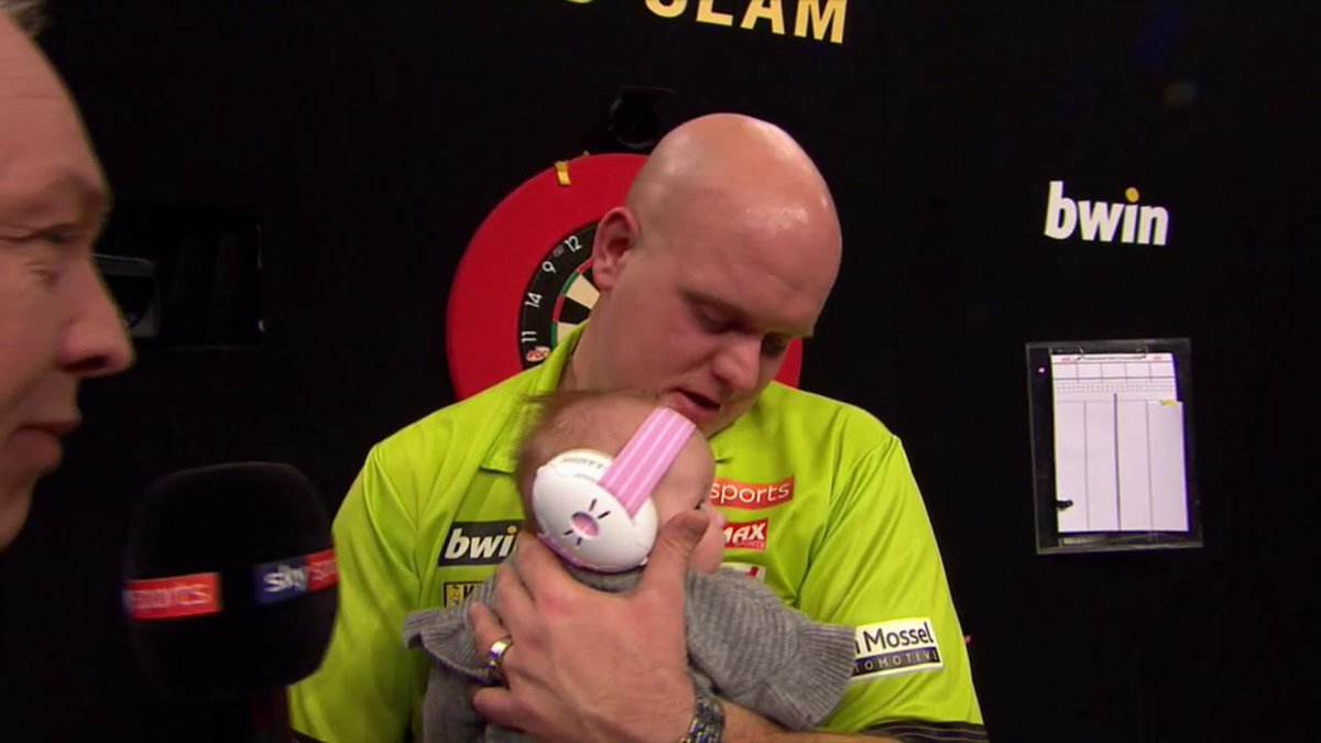New Snakebite fan in the making....? Peter Wright gives baby Van Gerwen a Snakebite hair style #LovetheDarts