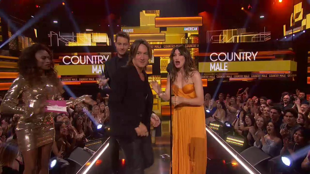 GO @KeithUrban! He's taking home the award for Favorite Male Artist - Country! #AMAs