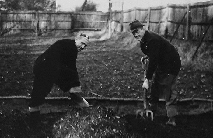 Here&#39;s my Grandfather Jack Cook (on the right) shovelling &#39;something&#39; in the #allotment gardens at Broadfield, Crawley, 1950s #gardenshour - Anybody else got #hortihistory photos?<br>http://pic.twitter.com/9V3Gdxse9U