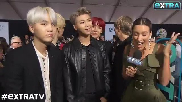.@BTS_twt causes a frenzy on the red car...