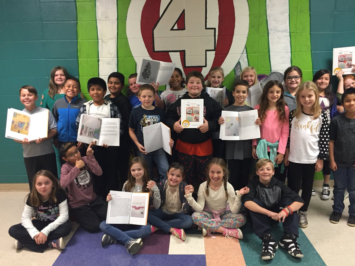 students show off shared work in school