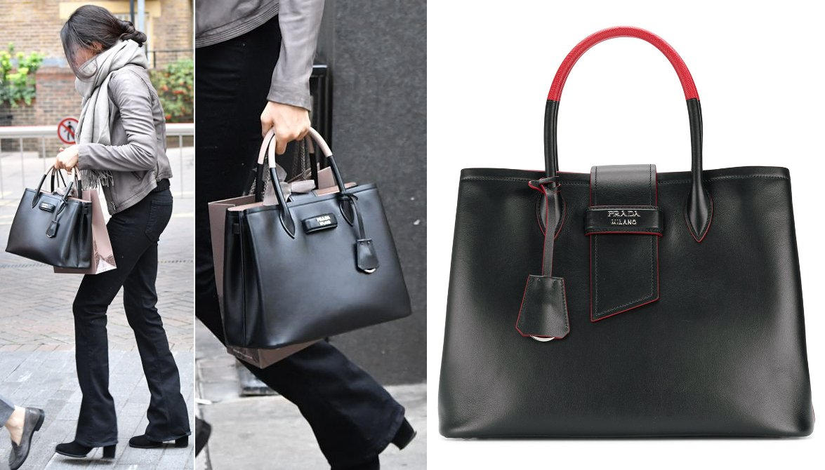 02a710ac6b3d I found a stock photo of #MeghanMarkle's Prada Paradigm tote bag, shown  below in the Black/Red colorway. The new season tote is available at  Farfetch > ...