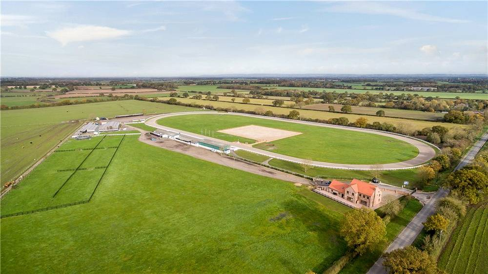 #Horse lovers!  #NunMonkton #York  #equestrian #property, 101 acres, 4 bedroom home, 50 #stables, #barn, #outbuildings, #ménage, all weather #racetrack, #spectator stand, #clubhouse and various fenced #paddocks including #riverfrontage.  OIEO £1,850,000   http:// ow.ly/3k2y30gKbFL  &nbsp;  <br>http://pic.twitter.com/c6YNOtUPfe