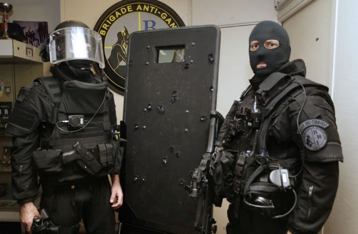 French Police assault team members, standing next to the shield they used during the #Bataclan Attack, on the 13rd Nov. 2015. Balls of steel, indeed.  http:// 9gag.com/gag/azqzpOq  &nbsp;   <br>http://pic.twitter.com/UUix4lnW6S