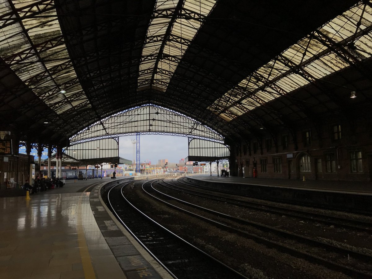 Cool train station in Bristol with a bird waiting for the train to Paddington.
