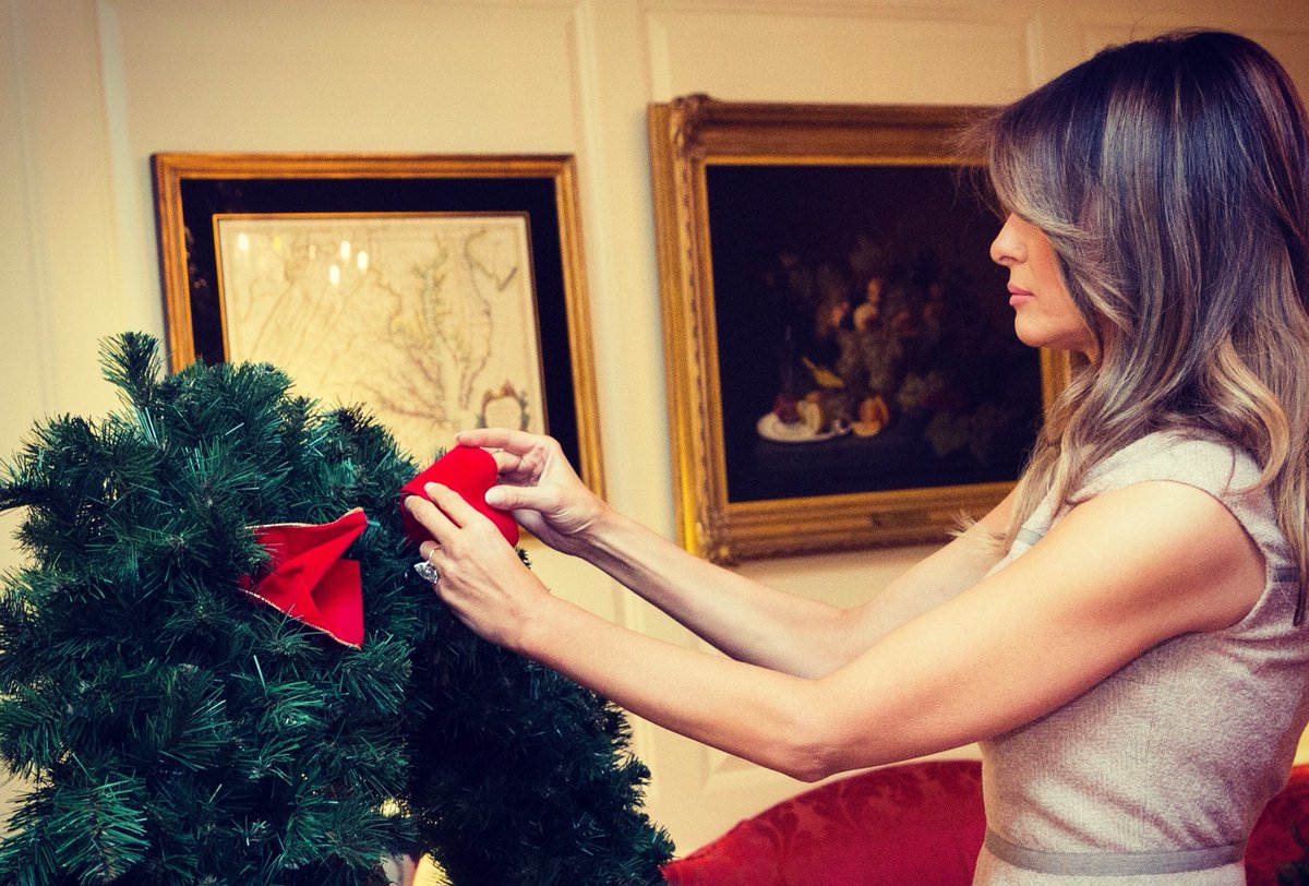 trump also lent a hand to add a life size bow thousands of volunteers assist staff members for months to deck the halls of the white house