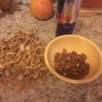 Cracking almonds for sweets for Thanksgiving tomor...