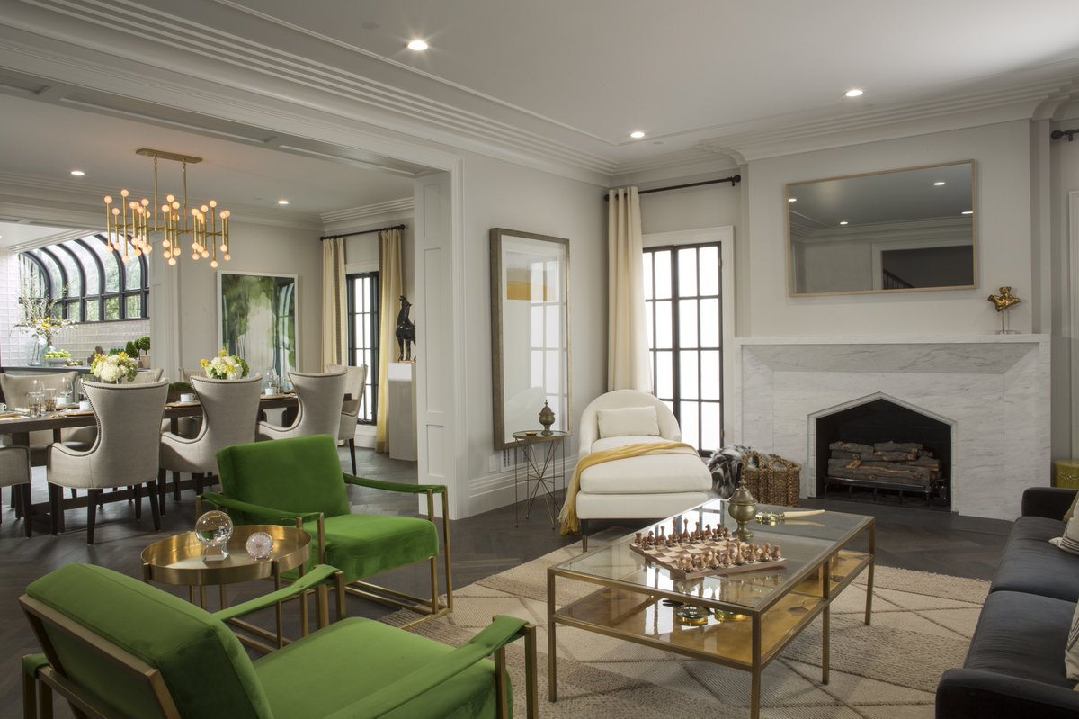 Eclectic style and bold green chairs in living room of Drew's honeymoon house by #PropertyBrothers in LA