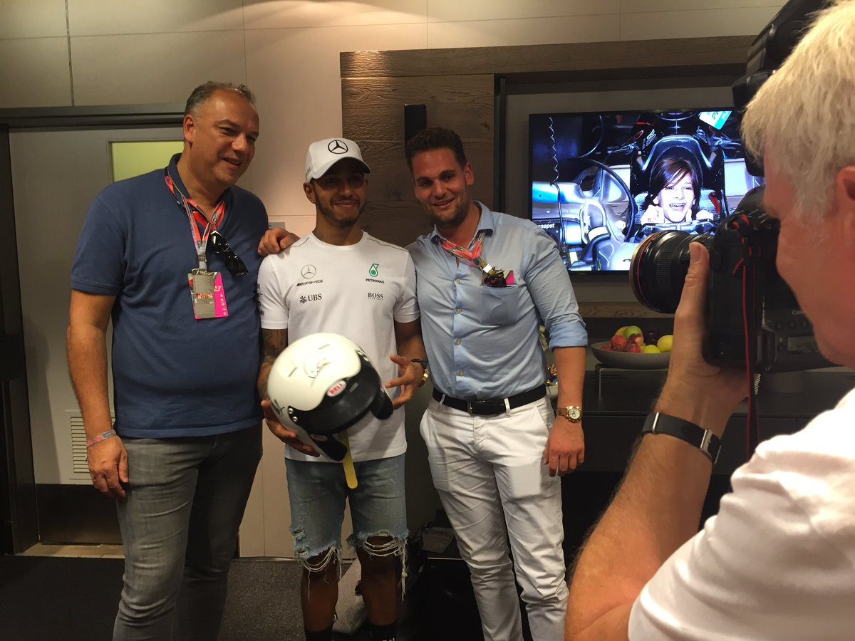 Patrick guttenberg on twitter supporting susangkomen leads to i was very lucky to get a meet greet with lewishamilton in return got the usainbolt helmet also thanks to charitybuzz and f1 m4hsunfo